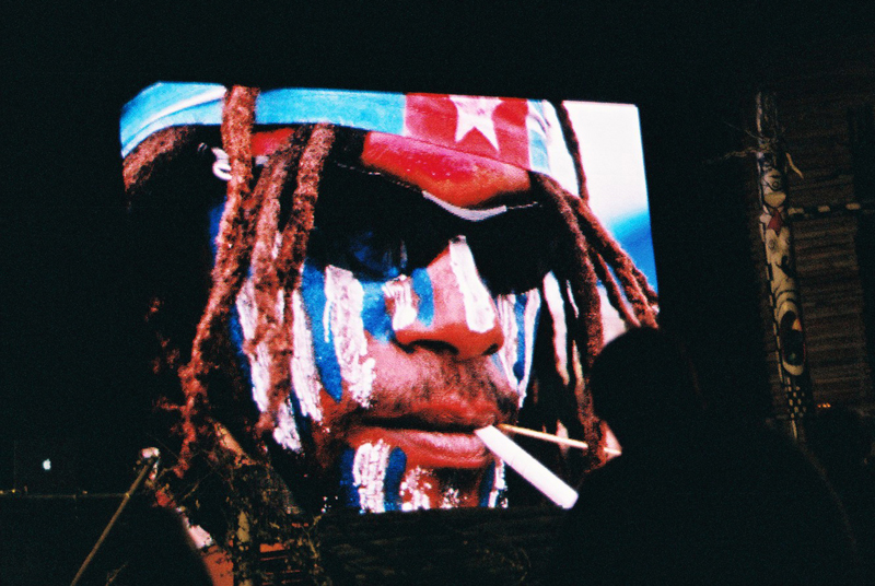 West Papuan man with dreadlocks and face paint at Benny Wenda's talk at the Liminal Village at Boom Festival 2014, Portugal. Photo Sophie Pinchetti.